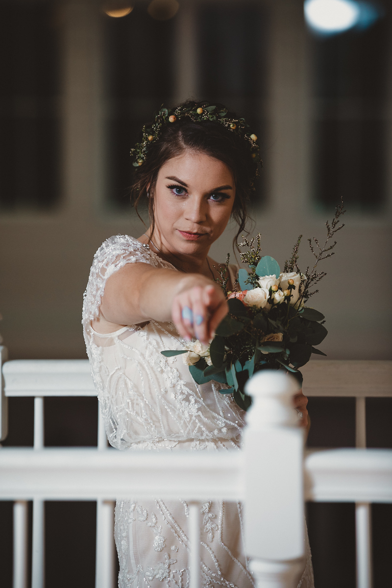 A bride pointing at the camera