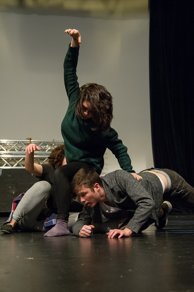 Students (from top to bottom) Sierra Priest, Kimberly Merry, and Ben Hudson contort their bodies together to create an unusal and abstract stage picture in Movement Class.