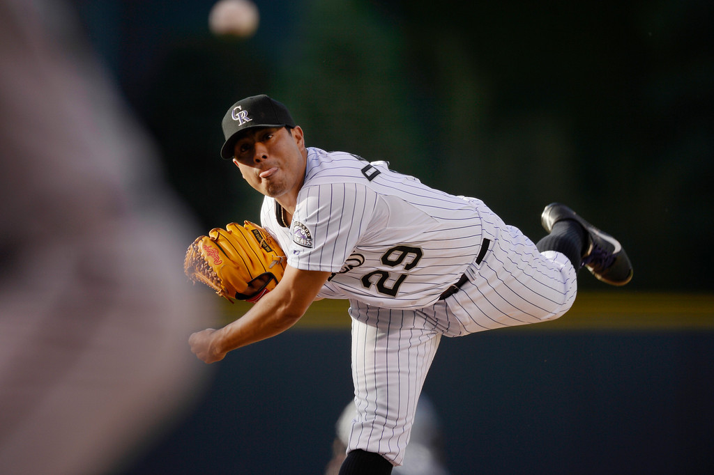 . Colorado Rockies starting pitcher Jorge De La Rosa (29) delivers a pitch against the Arizona Diamondbacks during the first inning June 3, 2014 at Coors Field. (Photo by John Leyba/The Denver Post)