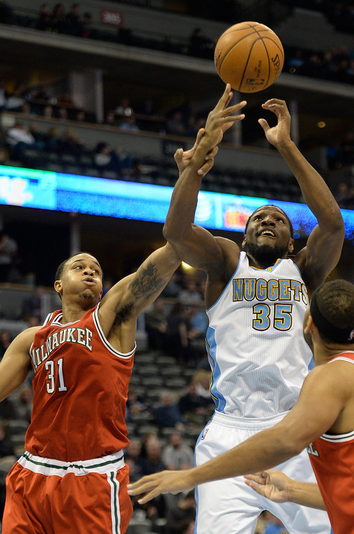 . DENVER, CO - MARCH 03: Kenneth Faried (35) of the Denver Nuggets battles John Henson (31) of the Milwaukee Bucks for a rebound  during the second half of a 106-95 Nuggets win. The Denver Nuggets hosted the Milwaukee Bucks at the Pepsi Center on Tuesday, March 3, 2015. (Photo by AAron Ontiveroz/The Denver Post)