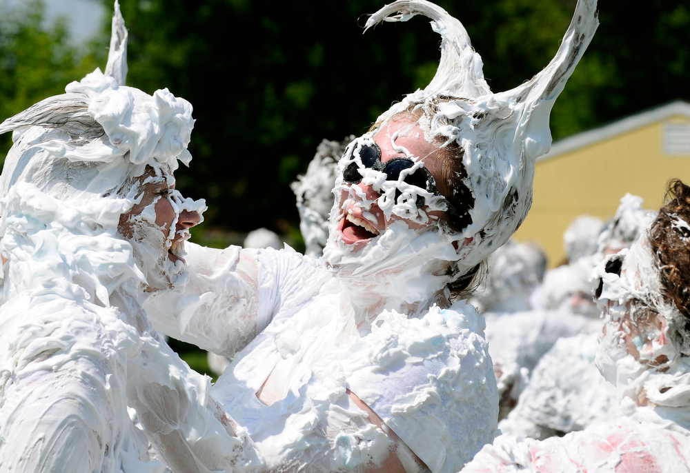 . Grand Ledge High School seniors have fun together with a shaving cream fight after their last day of school Friday, May 28, 2010 in Grand Ledge, Mich. (AP Photo/Lansing State Journal, Rod Sanford)