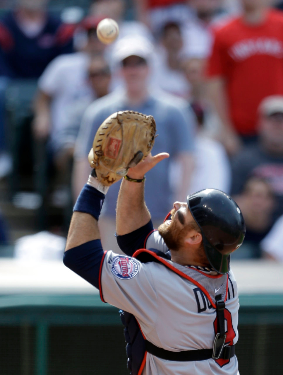 . Minnesota Twin catcher Ryan Doumit catches a foul ball hit by Cleveland Indians\' Nick Swisher in the seventh inning. The Indians won 7-3. (AP Photo/Tony Dejak)