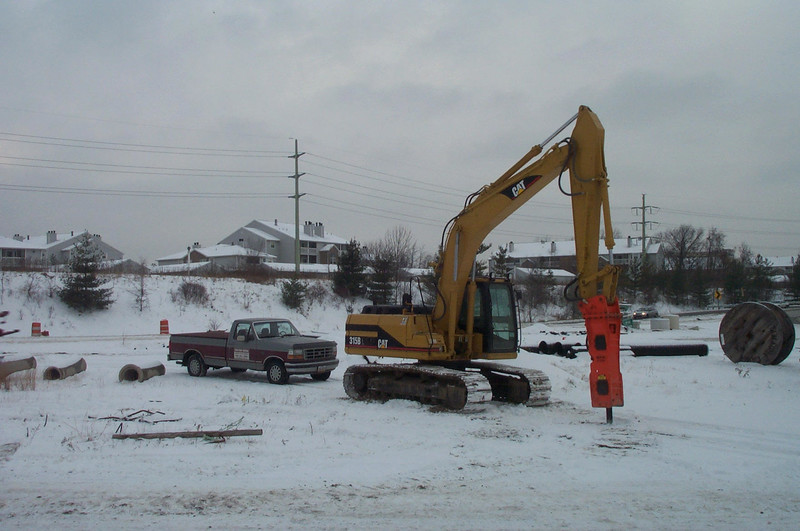 NPK E208 hydraulic hammer on Cat excavator.jpg