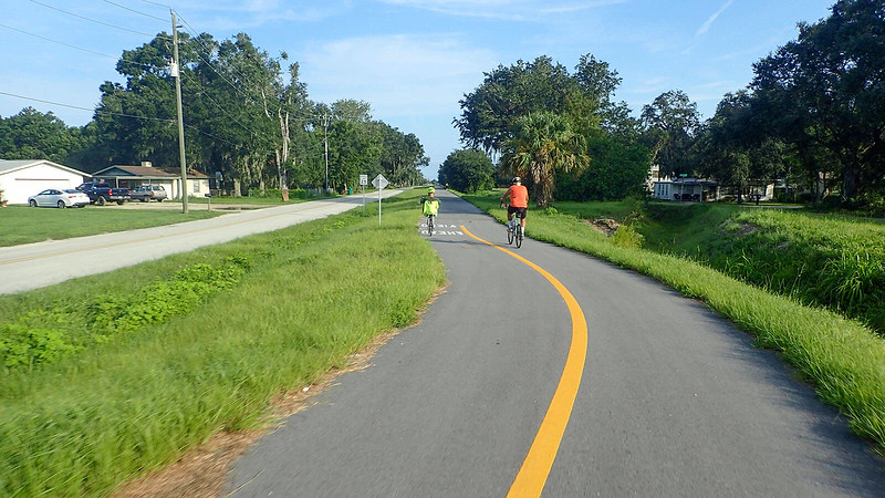 Cyclists on bike path in Mims