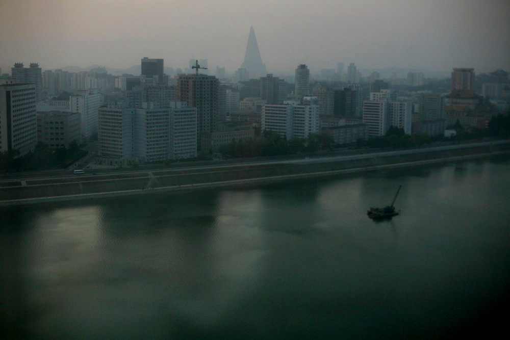 Description of . A view of Pyongyang, North Korea, at dusk on Tuesday, Sept. 16, 2008. North Korea upped the ante in the standoff over its nuclear program, confirming that it is restoring a key atomic reactor and saying it no longer cares to be removed from Washington's terrorism blacklist.  (AP Photo/David Guttenfelder)