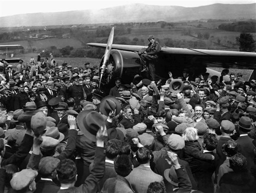 . FILE - In this May 22, 1932 file photo, a crowd cheers Amelia Earhart as she boards her single-engine Lockheed Vega airplane in Londonderry, Northern Ireland, for the trip back to London.  (AP Photo/File)