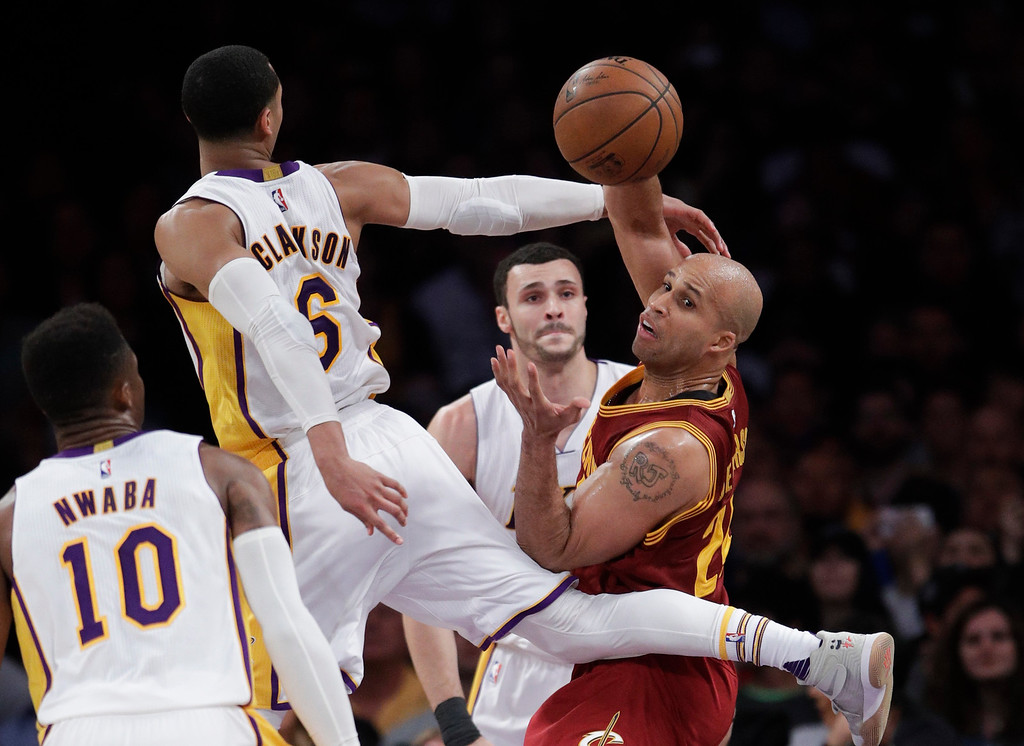 . Cleveland Cavaliers\' Richard Jefferson, right, passes the ball under defense by Los Angeles Lakers\' Jordan Clarkson during the second half of an NBA basketball game Sunday, March 19, 2017, in Los Angeles. The Cavaliers won 125-120. (AP Photo/Jae C. Hong)