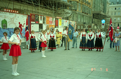 Local folk dressed for a performance of some sort.  The ladies look especially impressive  in their traditional costumes.  The flags they are holding appear to be very similar to Norwegian, but I'm not sure.  I should have asked that lovely lady in the yellow Macy's bargain basement costume!