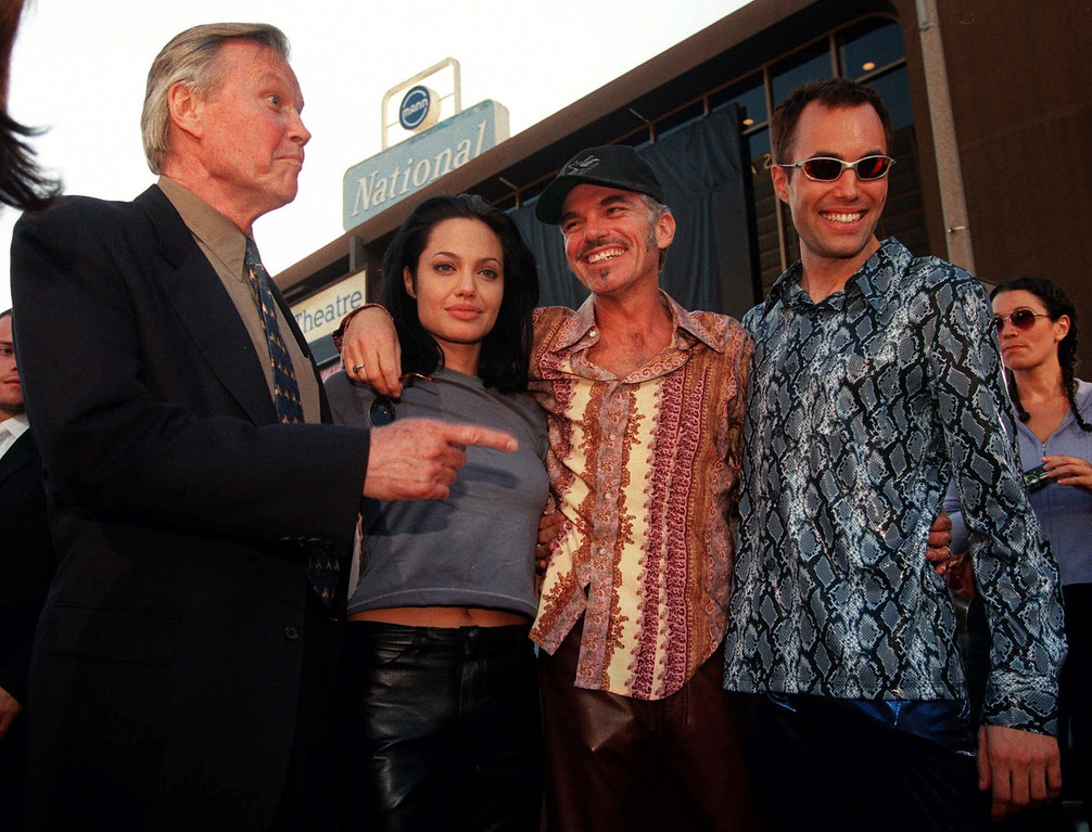 """. Actress Angelina Jolie, second from left, one of the stars of the new action film \""""Gone in 60 Seconds,\"""" poses with her new husband, actor Billy Bob Thornton, second from right, her father, actor Jon Voight, left, and her brother James Haven Voight at the premiere of the film in Los Angeles, Monday, June 5, 2000. (AP Photo/Chris Pizzello)"""