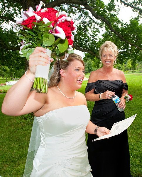 ChristaTom_BrideWavingBouquet.jpg