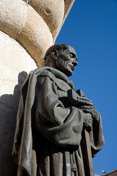 Monument to San Pedro de Alcantara against the wall of Caceres Cathedral, Spain