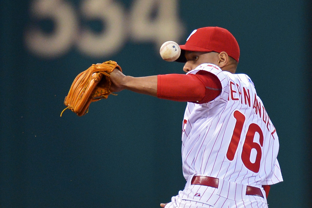 . Cesar Hernandez #16 of the Philadelphia Phillies makes an error in the second inning against the Colorado Rockies at Citizens Bank Park on May 28, 2014 in Philadelphia, Pennsylvania.  (Photo by Drew Hallowell/Getty Images)