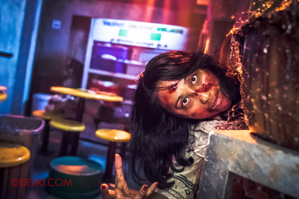 Halloween Horror Nights 6 - Hawker Centre Massacre / woman hiding behind basket