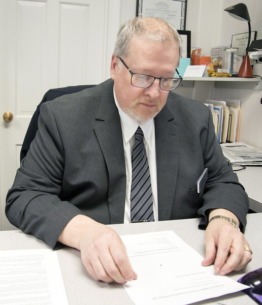 03/19/20   Wesley Bunnell | Staff  Robert Bruzy of New Britain Memorial - Sagarino Funeral Home looks over the most recent paperwork guidelines from the CDC which was received later in the day on Thursday March 19, 2020.  The initial report a week ago was 4 pages while todays report totaled 10 pages.