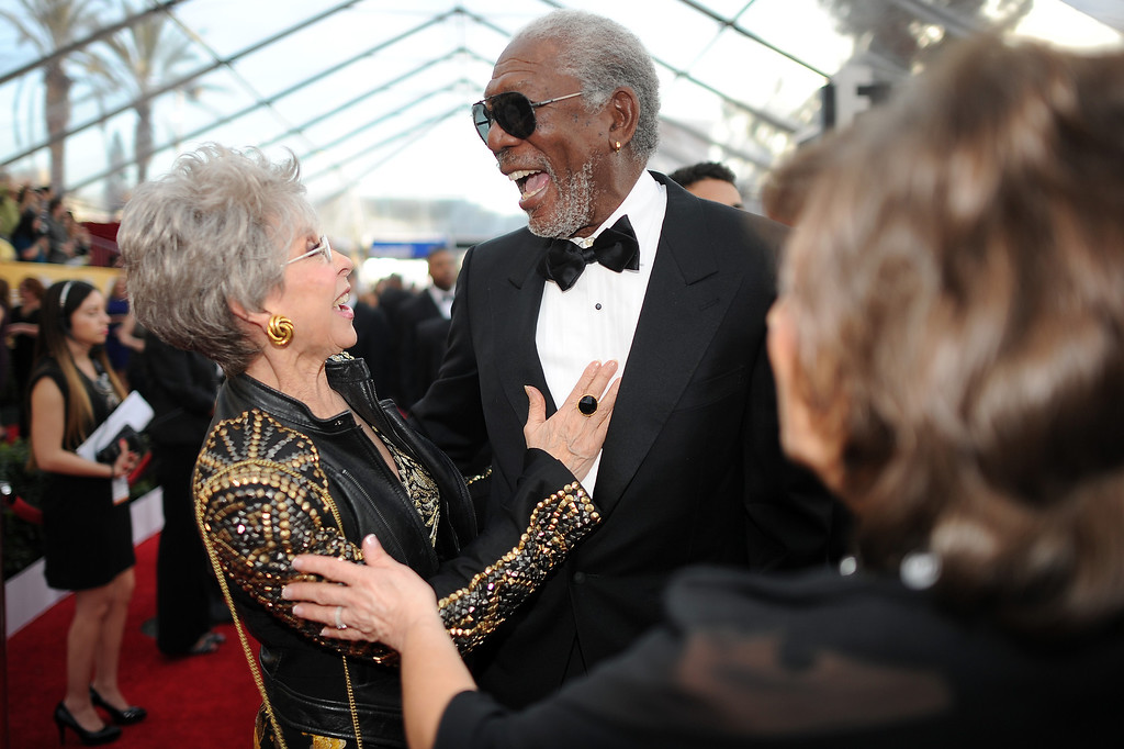 . Rita Moreno (L) and Morgan Freeman on the red carpet at the 20th Annual Screen Actors Guild Awards  at the Shrine Auditorium in Los Angeles, California on Saturday January 18, 2014 (Photo by Hans Gutknecht / Los Angeles Daily News)