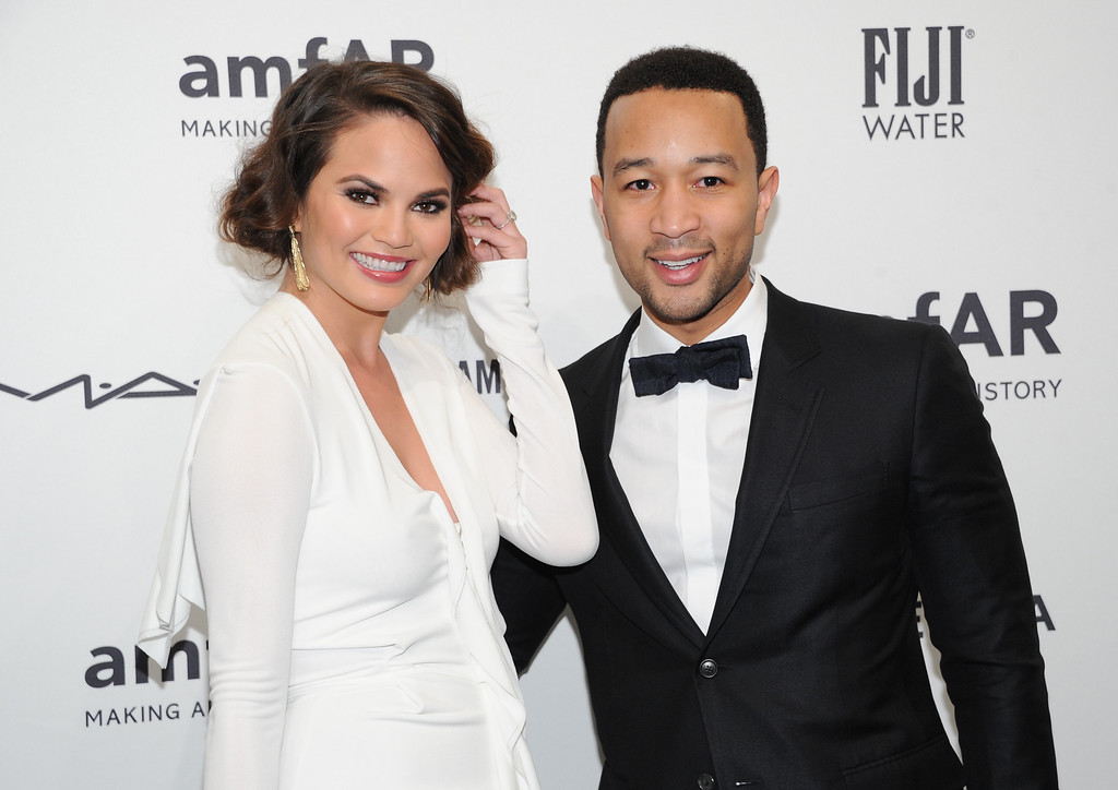 . Singer John Legend and fiancee, model Chrissy Teigen, attend amfAR\'s New York gala at Cipriani Wall Street on Wednesday, Feb. 6, 2013 in New York. (Photo by Evan Agostini/Invision/AP)