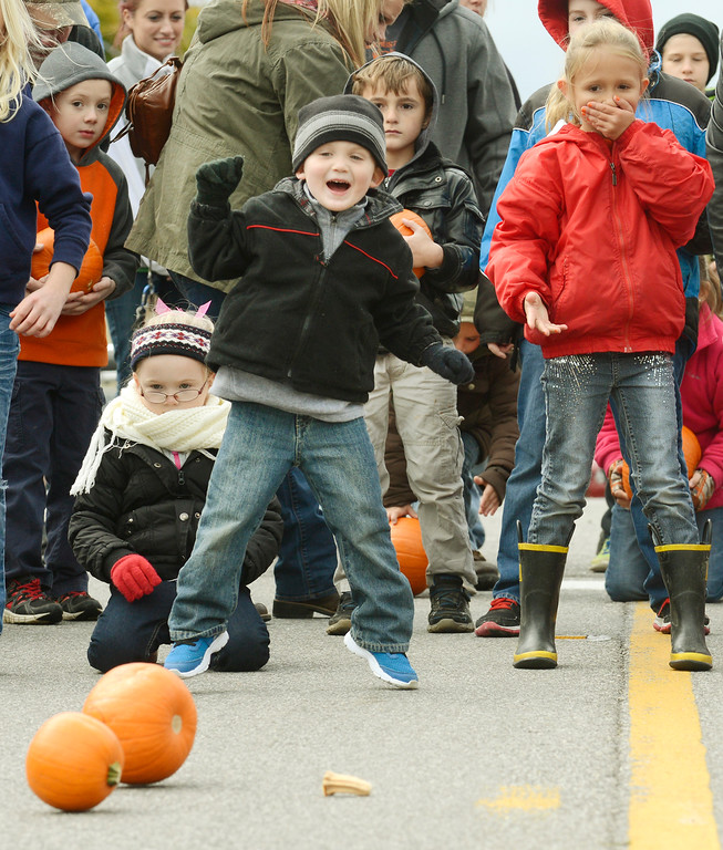. Oliver Saunders jumps as his pumpkins rolls down the hill during Huntsburg Township\'s annual pumpkin festival in 2014. The event returns for its 48th year, on Oct. 7 and 8. For more information, visit huntsburgpumpkinfestival.com. (News-Herald file)