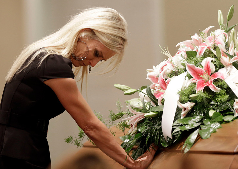 . Jill Stancel places her hand on the casket of country music star Mindy McCready during the funeral ceremony at the Crossroads Baptist Church in Fort Myers, Fla., Tuesday, Feb. 26, 2013.  McCready committed suicide Feb. 17 at her home in Arkansas, days after leaving a court-ordered substance abuse program. (AP Photo/Alan Diaz)