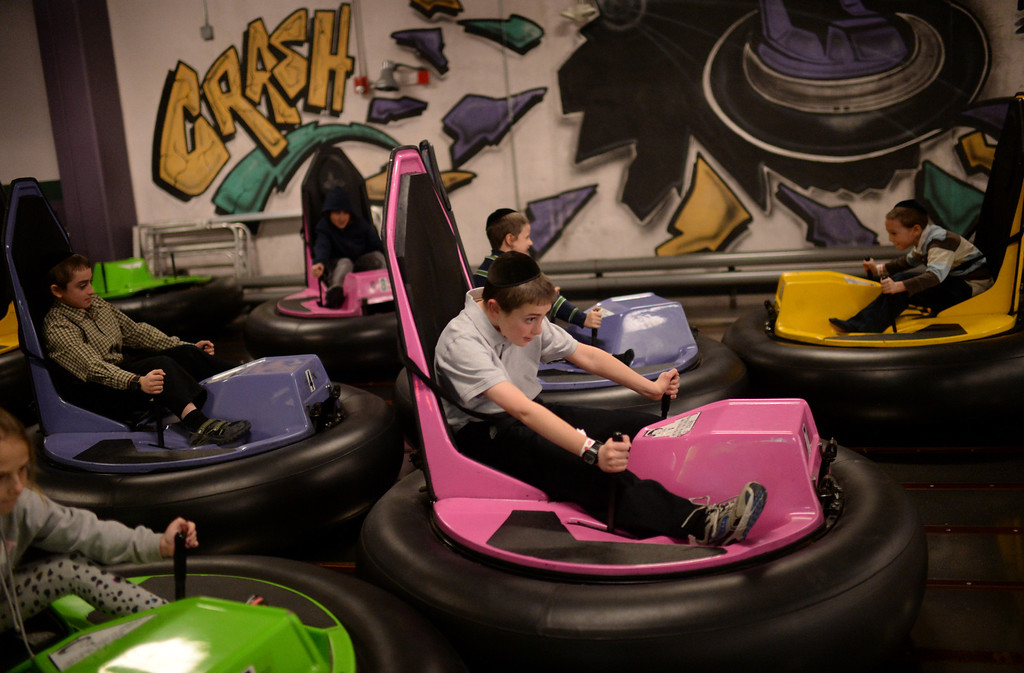 . CENTENNIAL, CO. DECEMBER 25: Youths enjoy riding the bumper cars at the the South Suburban Sports Center in Centennial, Colorado on December 25, 2013. For the fourteenth year, the Denver Community Kollel Women\'s Division is offering a Jewish Family Extravaganza of family fun and entertainment.  (Photo by Hyoung Chang/The Denver Post)