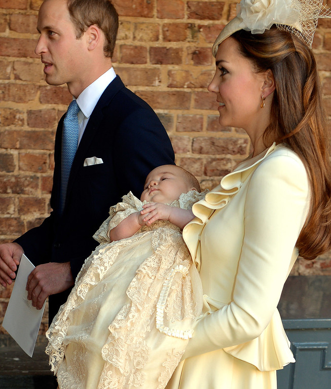 . Catherine, Duchess of Cambridge carries her son Prince George Of Cambridge  alongside the Prince William, Duke of Cambridge, following his christening at the Chapel Royal in St James\'s Palace, ahead of the christening of the three month-old Prince George of Cambridge by the Archbishop of Canterbury on October 23, 2013 in London, England. (Photo by John Stillwell - WPA Pool /Getty Images)