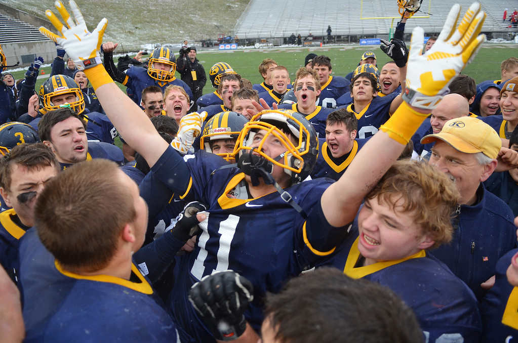 . Michael Allen Blair/ MBlair@News-Herald.com Kirtland wide receiver Sam Smith (11), and teammates celebrates Friday\'s 44-16 Div VI state championship victory over Wayne Trace at Fawcett Stadium in Canton.