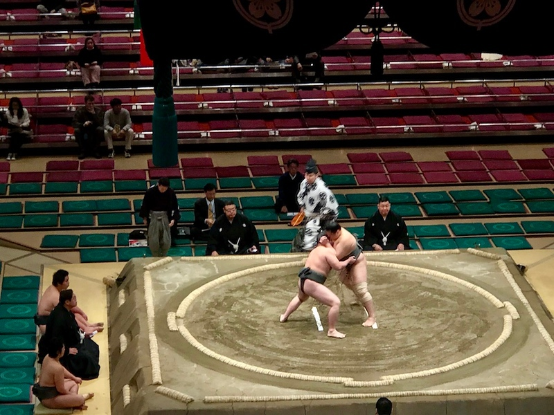 An early-morning sumo match