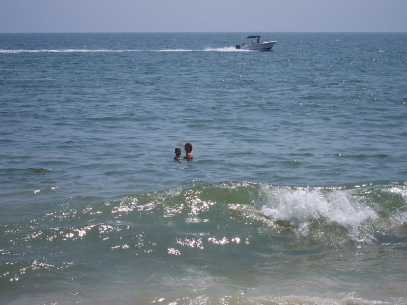 Laura and K.C. swim past  the breakers.
