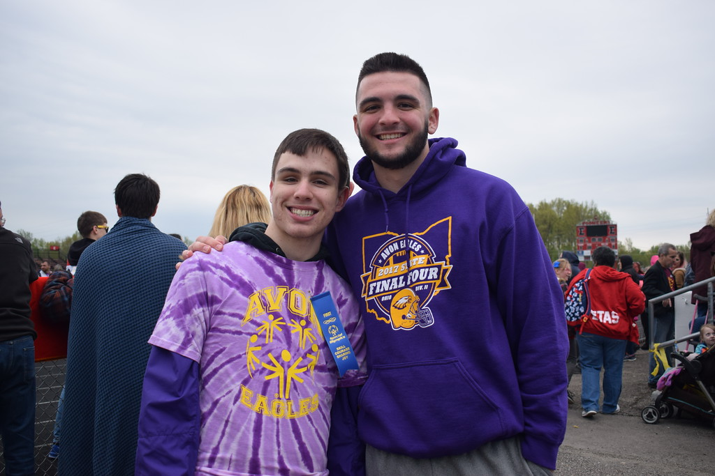 """. Briana Contreras � The Morning Journal <br> Left, Jake Darus, 18, and Alex Waters, 18, of Avon High School have been \""""buddies,\"""" for four years in the Lorain County Special Olympics. Darus and Waters are also neighbors. Waters cheered on Darus who competed in the 100-meter dash and the softball throw where he finished in first place at the 38th Annual Lorain County Special Olympics Track and Field Event held on May 11 at Ely Stadium in Elyria."""
