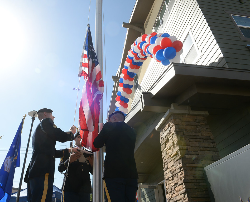 . The El Monte Army Career Center Color Guard raise the flags during the Grand Opening of the El Monte Veterans Village on Ramona Blvd. in El Monte on Wednesday March 12, 2014. The Veterans Village is a state-of-the-art veterans housing community includes 40 studio apartments. (Staff Photo by Keith Durflinger/San Gabriel Valley Tribune)