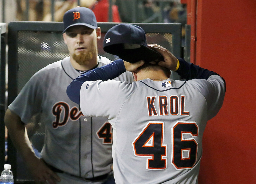 . Detroit Tigers pitcher Ian Krol (46) shouts as he leaves the dugout walking past fellow pitcher Phil Coke, left, during the eighth inning of a baseball game on Tuesday, July 22, 2014, in Phoenix. The Tigers\' Coke eventually earned the loss and Krol recorded a blown save as the Diamondbacks defeated the Tigers 5-4. (AP Photo)