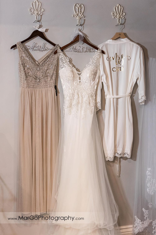 bridal dresses hanging in bridal suite at Sunol's Casa Bella