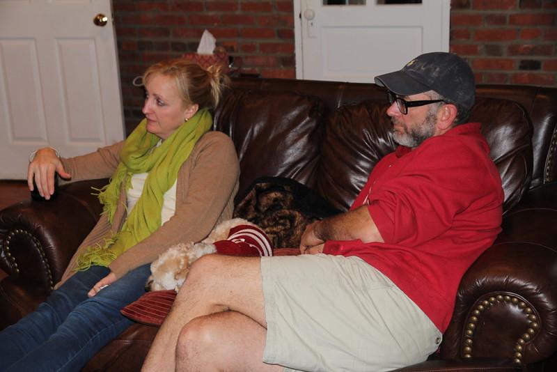 watching an Alabama game - notice BB has on an Alabama dog shirt (course he slept through the game)