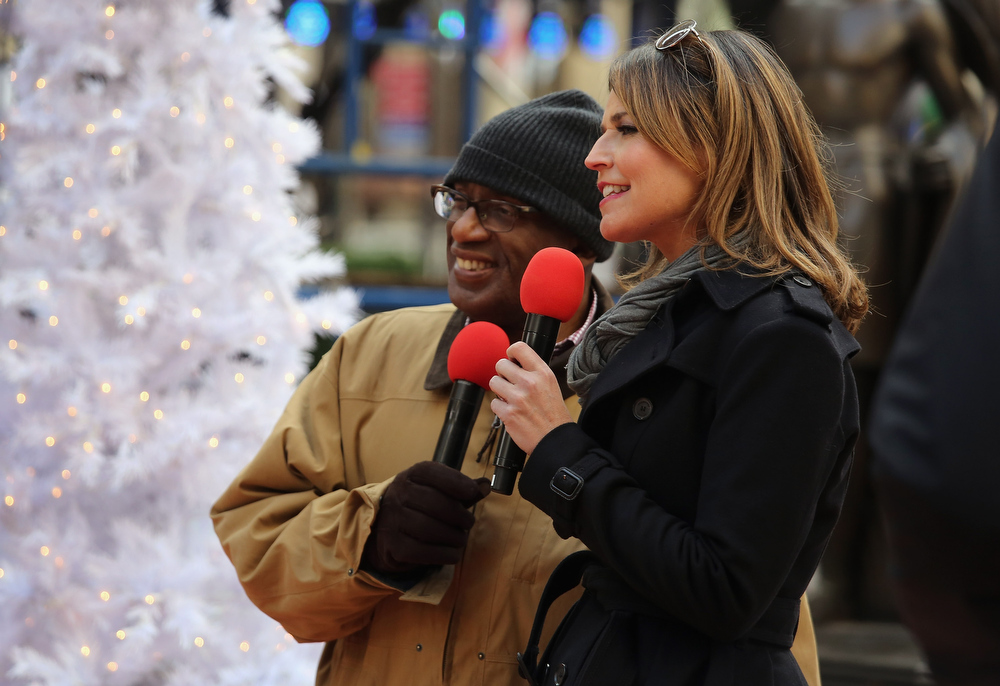 Description of . NBC hosts Al Roker (L) and Savannah Guthrie rehearse as preparations are made for the lighting of the Christmas tree at Rockefeller Center on November 28, 2012 in New York City. After two weeks of preparation, the 45,000 lights will be lit on the 80-foot high Norwegian spruce this evening during a celebration televised on NBC. The tree will remain lit every evening until January 7.  (Photo by John Moore/Getty Images)