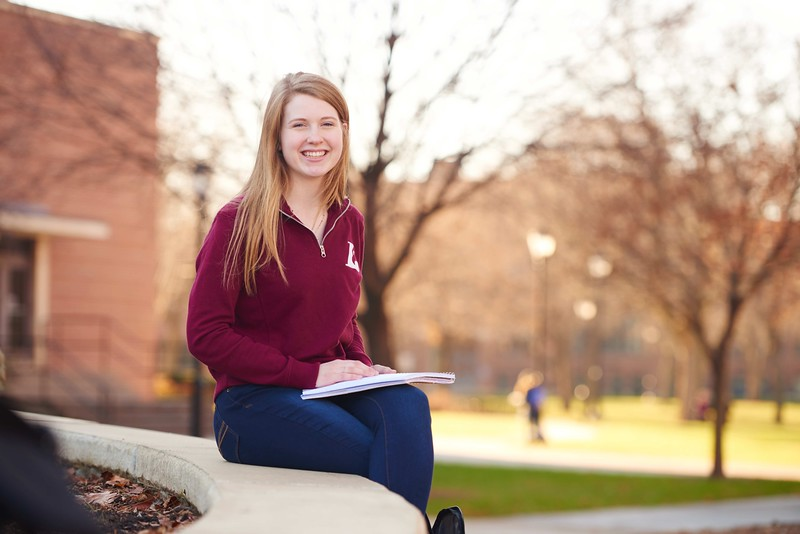 -UWL UW-L UW-La Crosse University of Wisconsin-La Crosse; day; December; Eagle L; Graff Main Hall; Notepad; Outside; Portrait; Smiling; Student students; Studying; sunny; Woman women