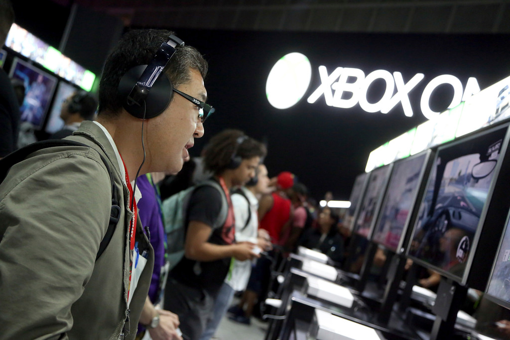 . IMAGE DISTRIBUTED FOR MICROSOFT - Fans play newly announced games at the Xbox booth at E3 2017 in Los Angeles on Tuesday, June 13, 2017. (Photo by Casey Rodgers/Invision for Microsoft/AP Images)