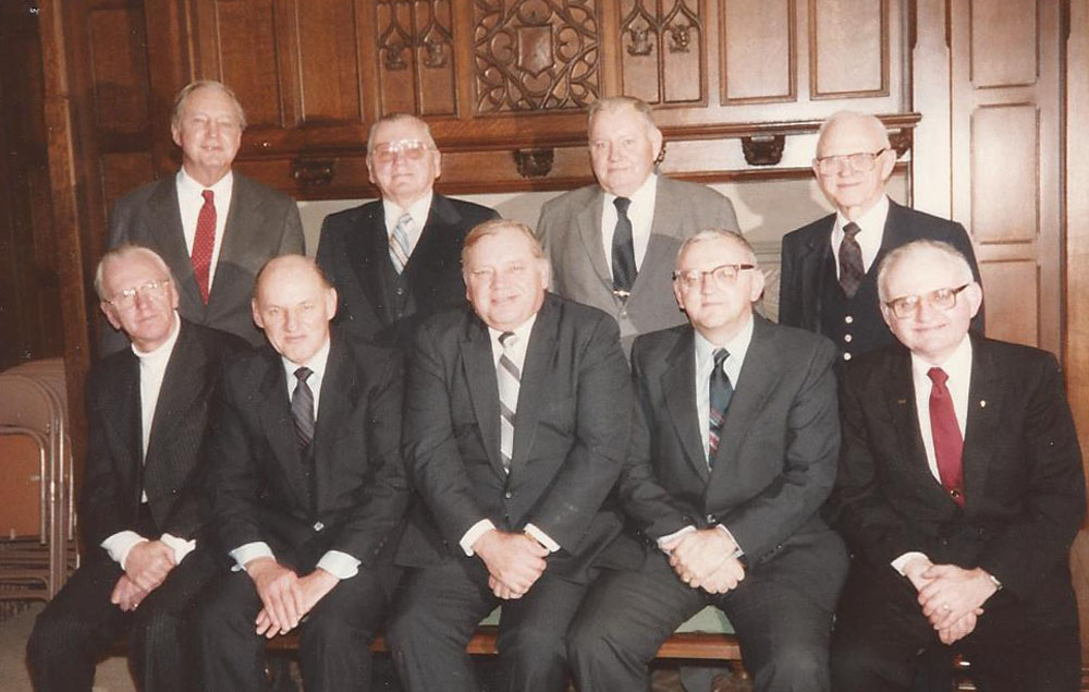 Description of . Edward Kuhn obit.   The pic of the Kuhn brothers are:Top row left to right Henry, Charlie, John Albert. Bottom row left to right Robert, George, Paul, Richard and Edward