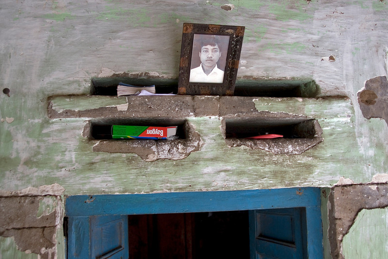 Photo frame and books atop a Balinese doorway in Indonesia