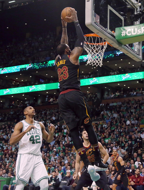 . Cleveland Cavaliers forward LeBron James dunks in front of Boston Celtics forward Al Horford (42) during the first half in Game 7 of the NBA basketball Eastern Conference finals, Sunday, May 27, 2018, in Boston. (AP Photo/Elise Amendola)