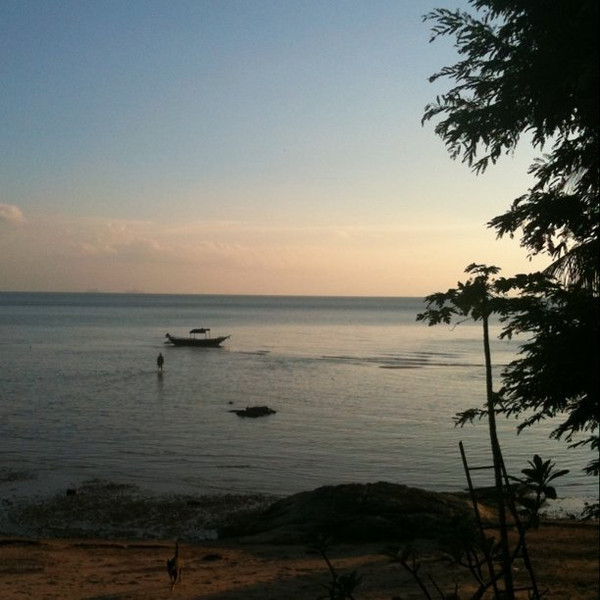 Dusk falling, fisherman going out to boat