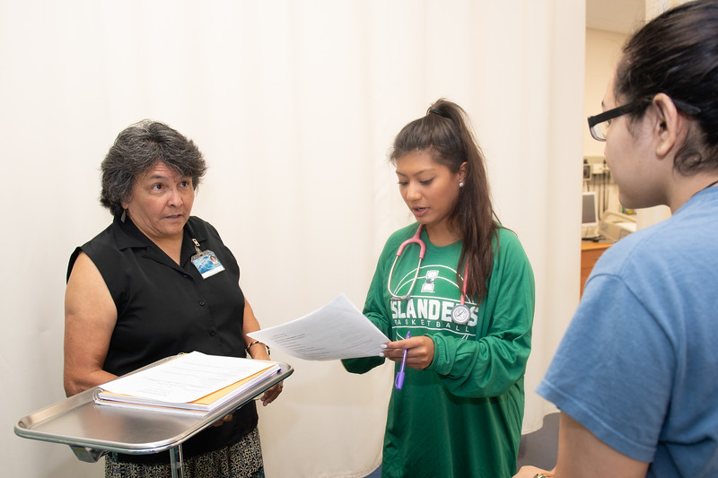 Professor Carmen Hernandez (left) assists Aliciana Mireles and Amber Merla with their lab in the nursing department.