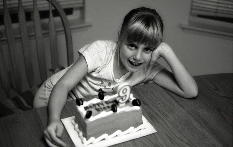 This is her birthday cake with the family - and check out those new braces.