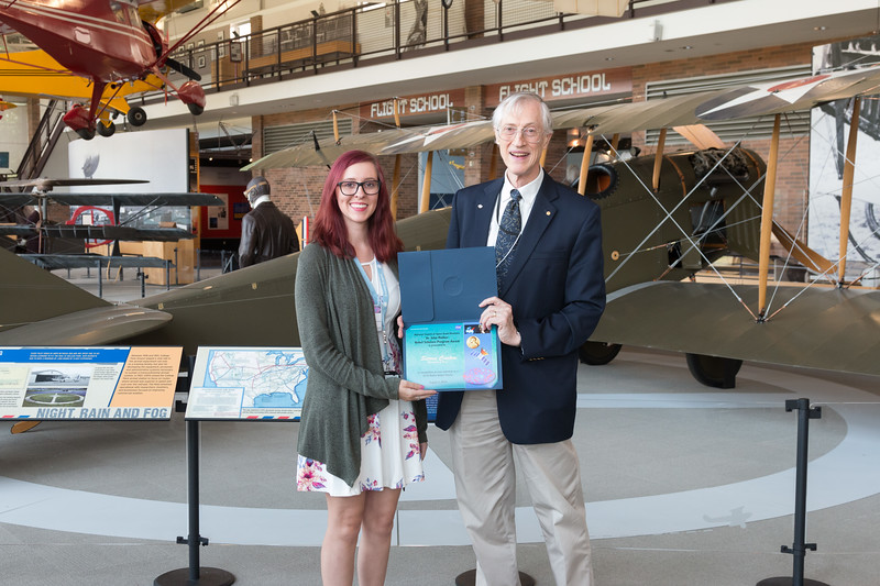 "Sierra Casten with John Mather, in front of Curtiss Jenny JN-4 -- An award luncheon, ""Dr. John Mather Nobel Scholars Program Award"", as part of the National Space Grant Foundation. College Park Aviation Museum, College Park, MD, August 2, 2019."