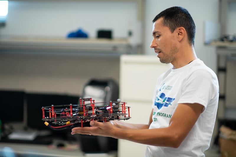 Dr. Luis Garcia presents a modular drone in the TAMU-CC UAS research lab.