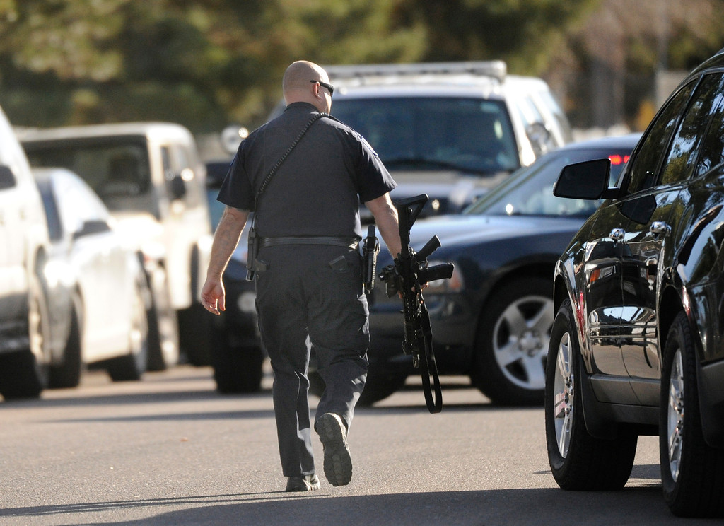 . CENTENNIAL, CO. - DECEMBER 13: Police took precautions to make sure that the situation was contained on the campus of Arapahoe High School Friday afternoon, December 13, 2013. A shooting inside the school sent hundreds of students rushing for safety. Photo By Karl Gehring/The Denver Post