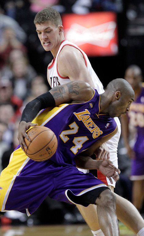 . Los Angeles Lakers guard Kobe Bryant, front, drives on Portland Trail Blazers center Meyers Leonard during the second half of an NBA basketball game in Portland, Ore., Wednesday, April 10, 2013.  Bryant scored 47 points as the Lakers won 113-106.(AP Photo/Don Ryan)