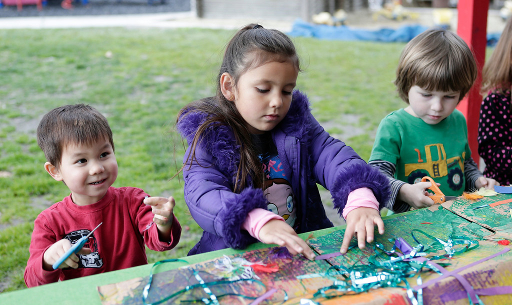 . Benjamin Hansen, 4, Moni Oseguera, 4, and Sean Aparisi, 4, work on a dragon to celebrate the Lunar New Year at the Mountain View Parent Nursery School in Mountain View, Calif. on Friday, Feb. 8, 2013. The Mountain View-Whisman School District has decided that if parents hold back an eligible child from kindergarten, it will help evaluate those children for kindergarten-readiness the following year. Some will be sent to first grade rather than kindergarten. (Gary Reyes/ Staff)
