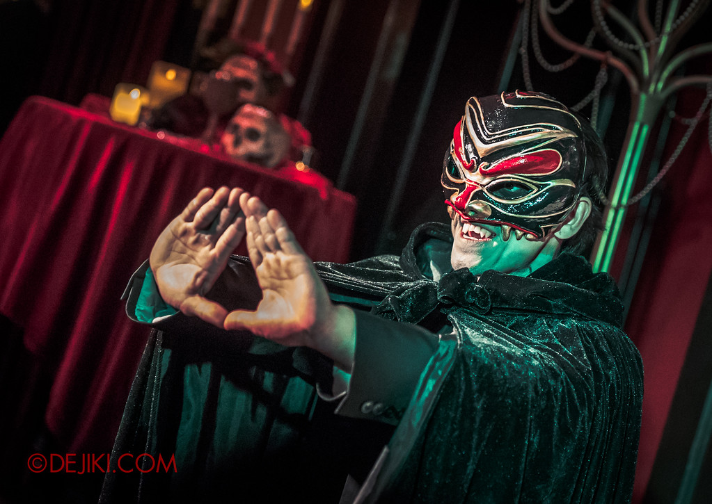 Halloween Horror Nights 8 Press Conference - Killuminati Haunted House Sacrifice Ceremony - Masked Cult Member performing Ritual Triangle Sign