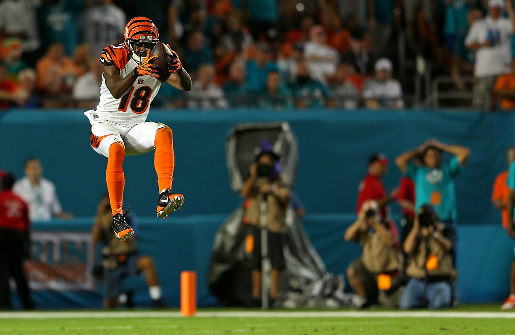 . MIAMI GARDENS, FL - OCTOBER 31: A.J. Green #18 of the Cincinnati Bengals makes a catch during a game against the Miami Dolphins at Sun Life Stadium on October 31, 2013 in Miami Gardens, Florida.  (Photo by Mike Ehrmann/Getty Images)