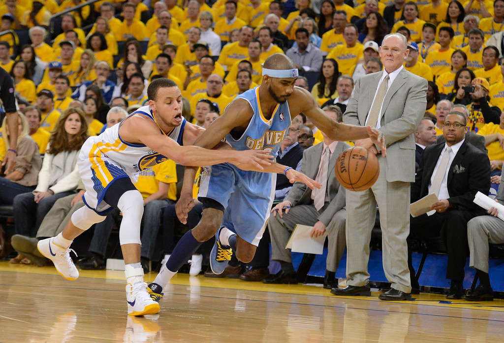 . OAKLAND, CA. - APRIL 26: Stephen Curry (30) of the Golden State Warriors reaches in on Corey Brewer (13) of the Denver Nuggets during the second quarter in game 3 of the first round of the NBA Playoffs April 26, 2013 at Oracle Arena.  (Photo By John Leyba/The Denver Post)