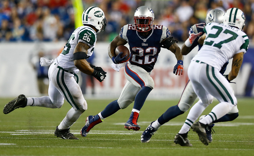 . Stevan Ridley #22 of the New England Patriots carries the ball against the New York Jets during the game at Gillette Stadium on September 12, 2013 in Foxboro, Massachusetts. (Photo by Jared Wickerham/Getty Images)